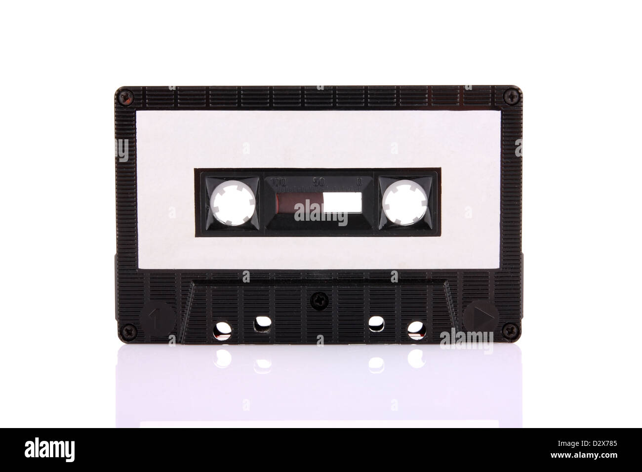 Compact Cassette isolated on white with blank white label. Including clipping path. - Stock Image