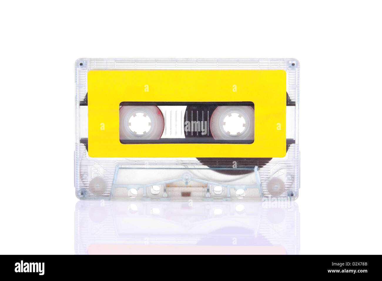 Compact Cassette isolated on white with blank yellow label. Including clipping path. - Stock Image