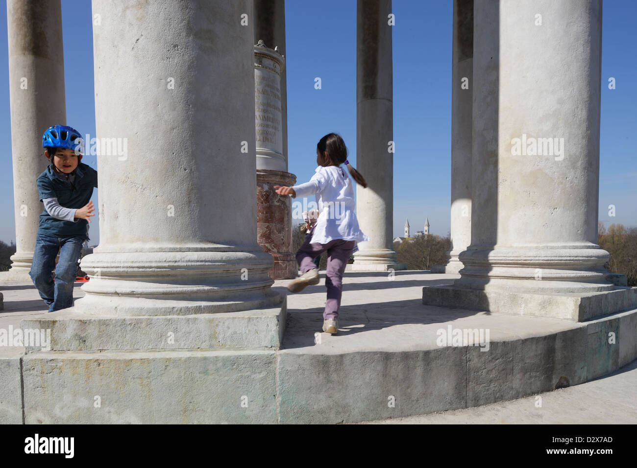 Munich, Germany, kids playing in the English Garden Monopteros Stock Photo