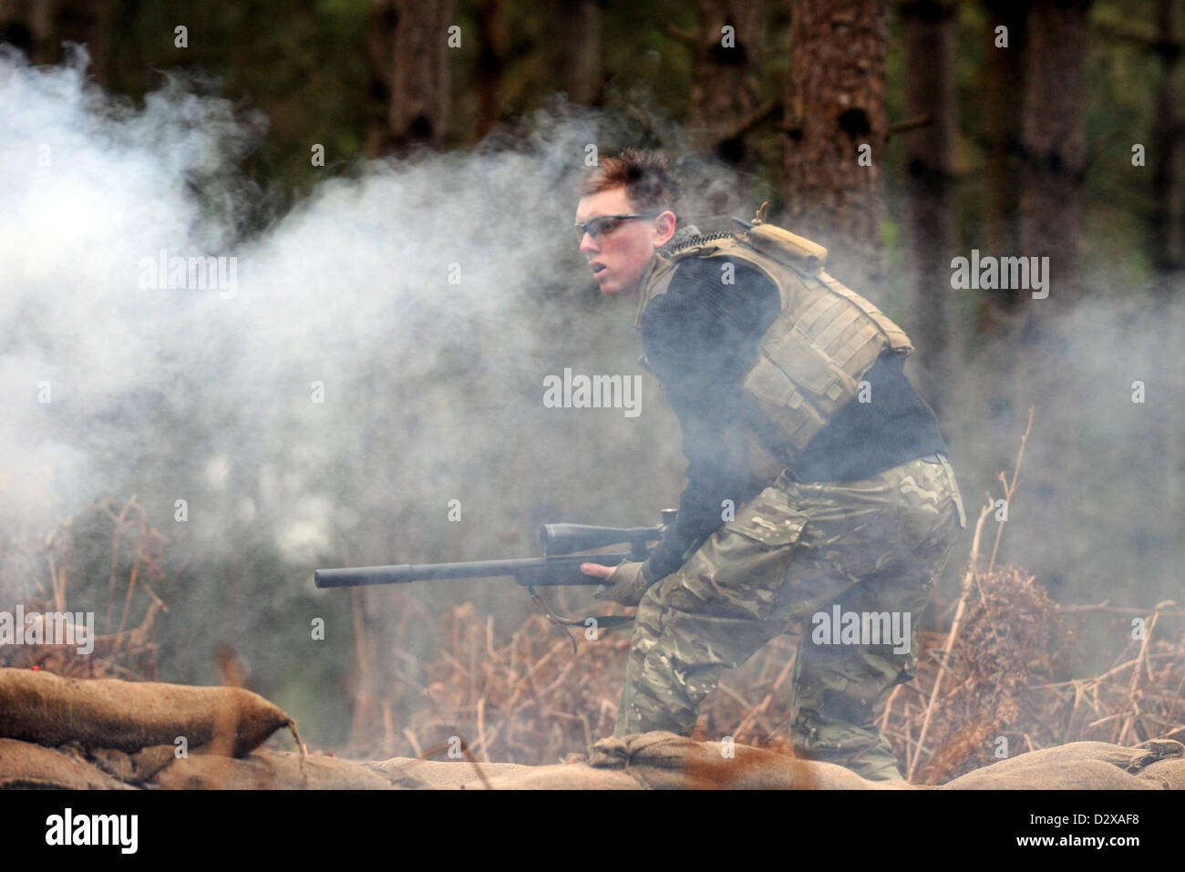 Airsoft sniper, participant in action during an airsoft game, UK - Stock Image