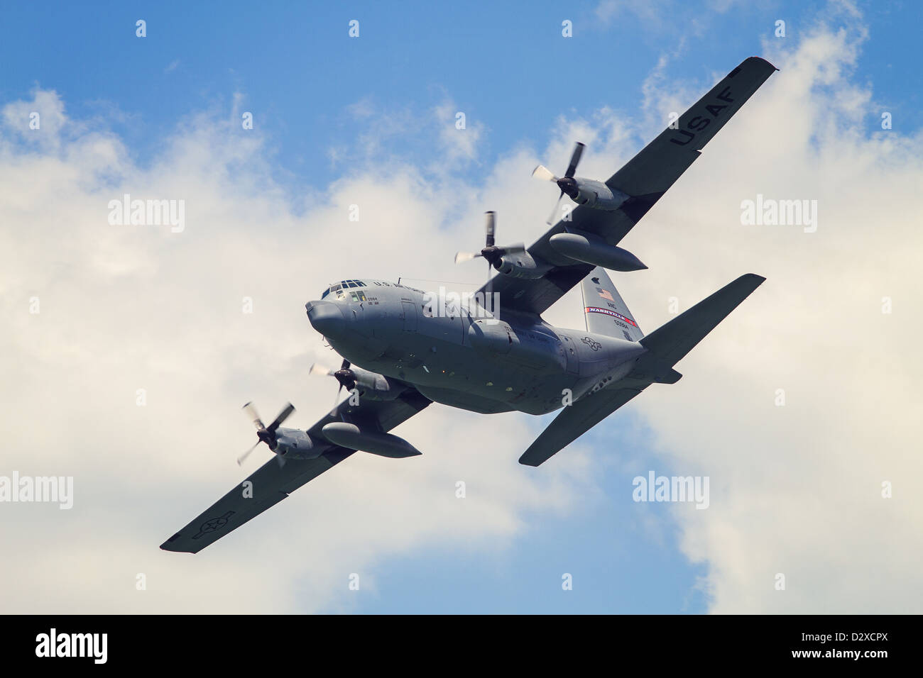 A C130 military plane banks in the sky Stock Photo