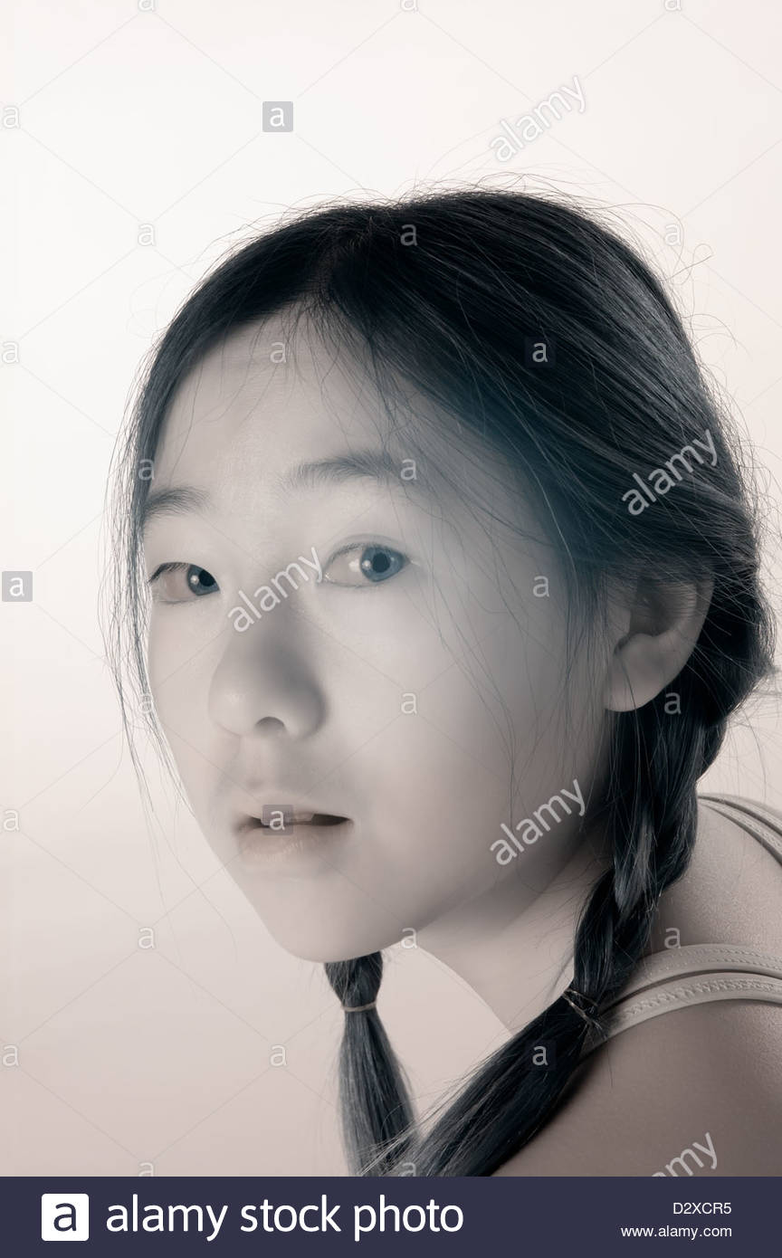 Infra-red portrait of a young Asian girl. - Stock Image