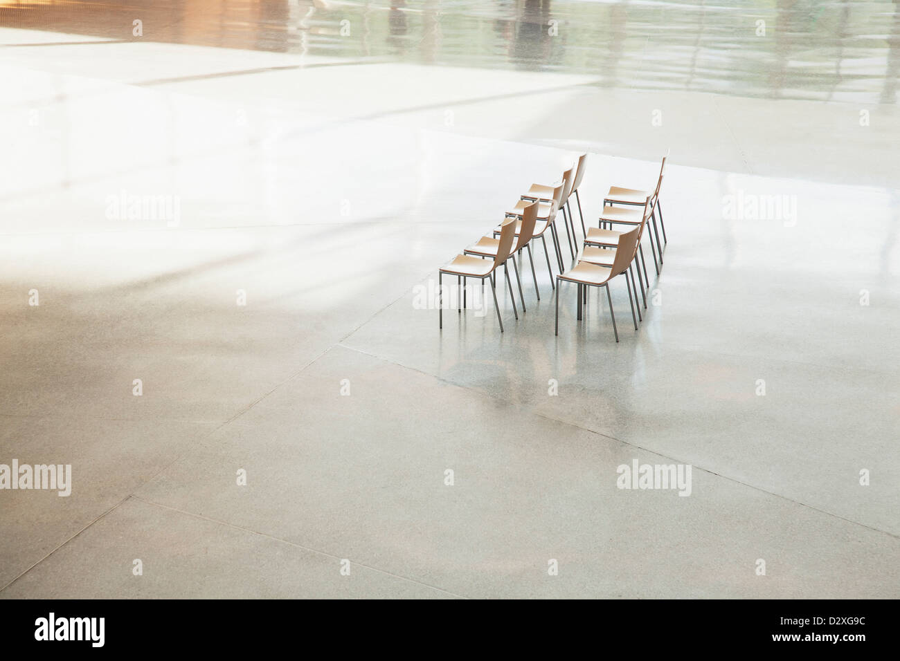 Chairs in a row in empty lobby - Stock Image