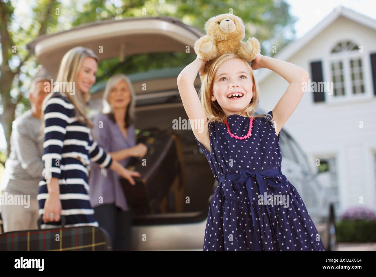 Girl carrying teddy bear on her head Stock Photo