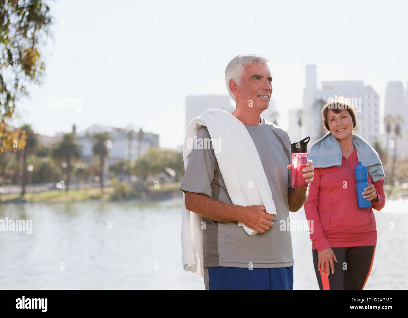 Older couple drinking water after workout Stock Photo