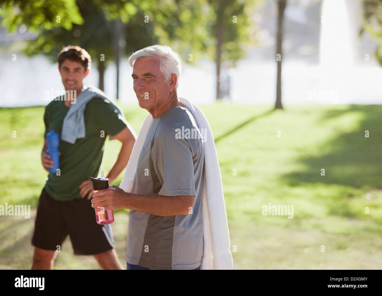 Men drinking water after workout Stock Photo