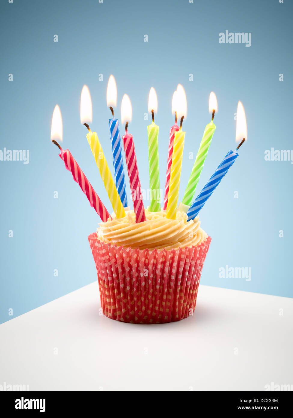 close up of cupcake with lit birthday candles stock photo 53444376