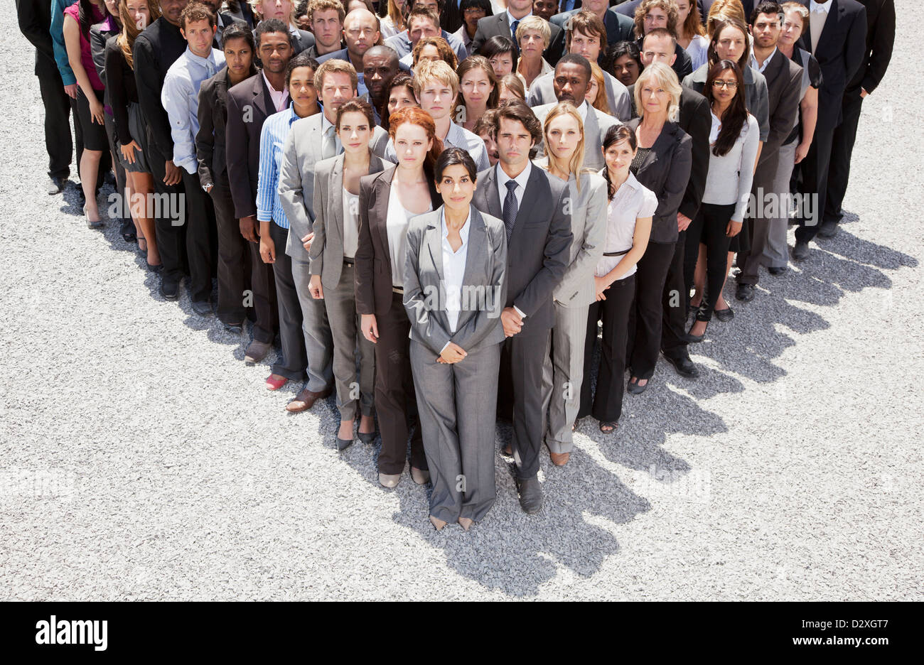 Portrait of business people forming triangle - Stock Image