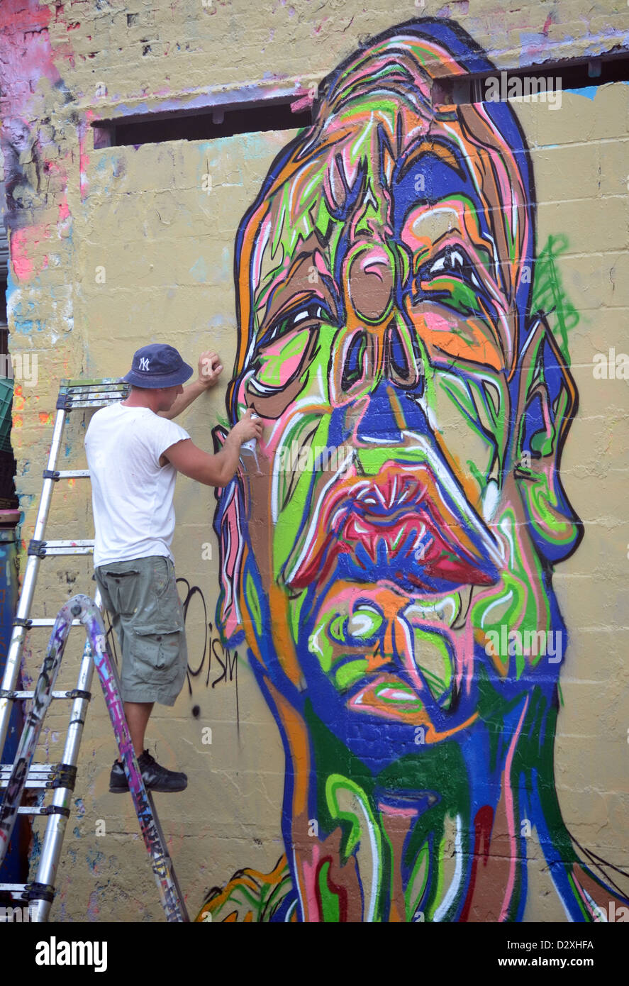 Graffiti artist painting at 5 pointz in long island city queens new york