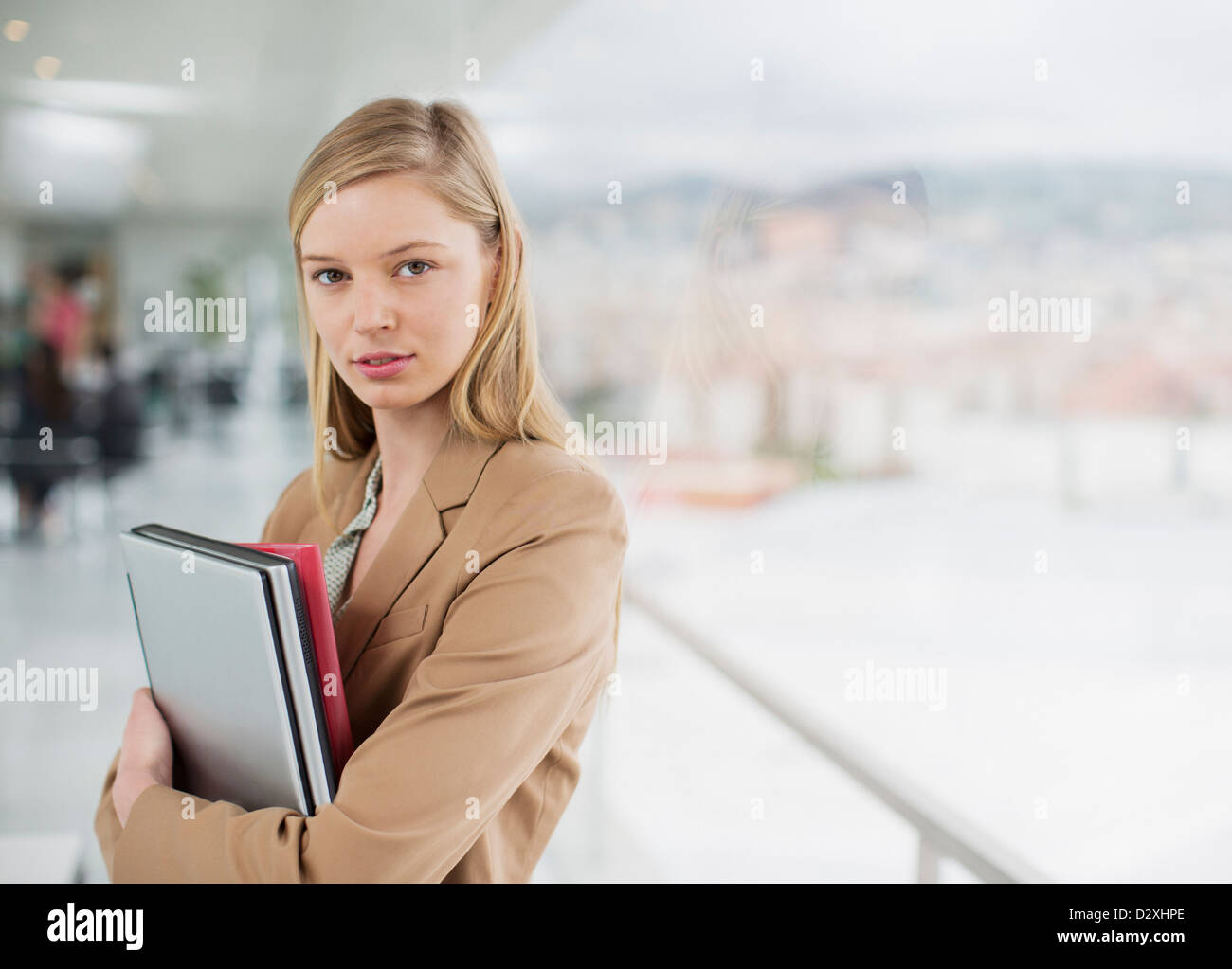 Portrait of serious businesswoman at window Stock Photo