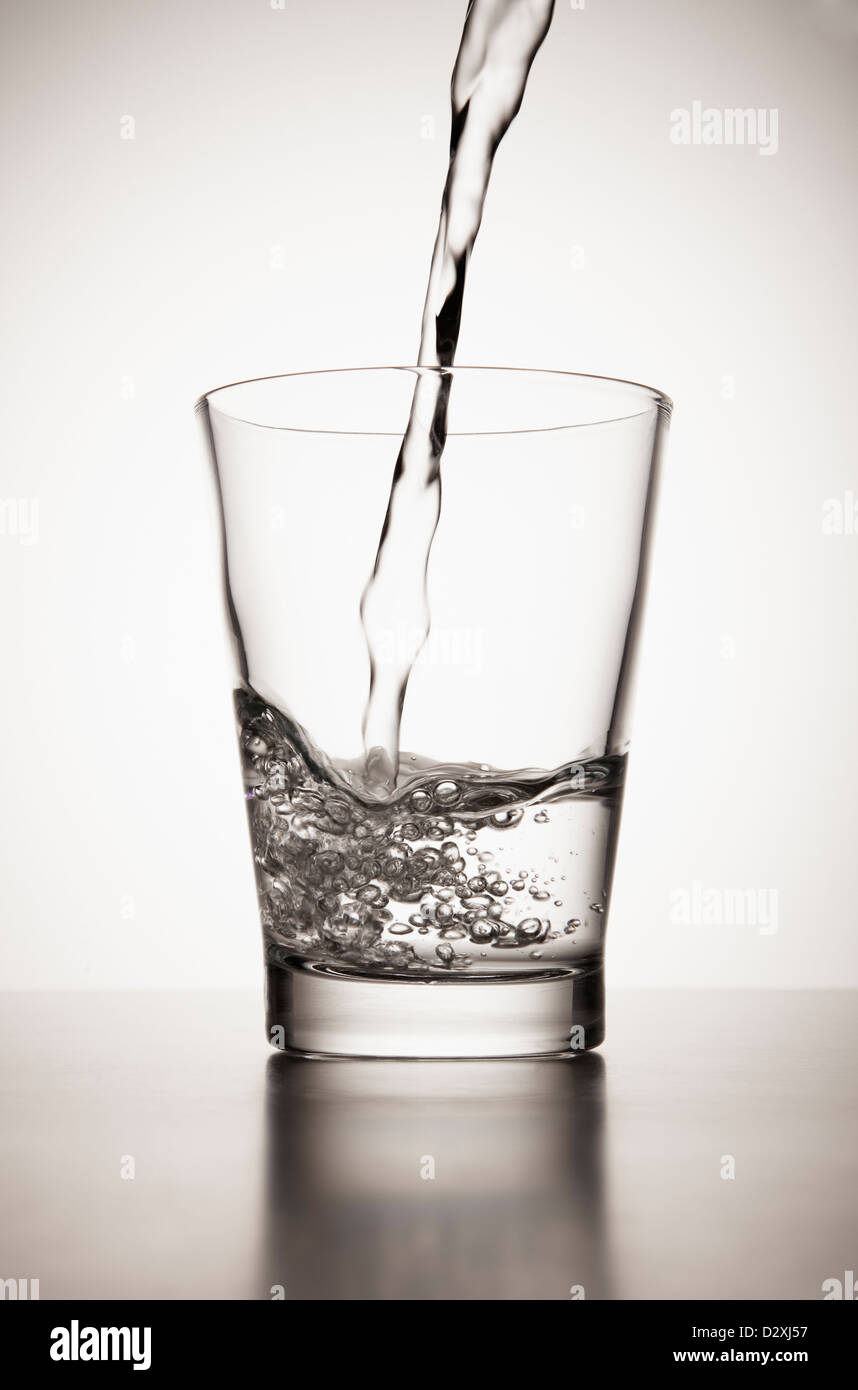 Water pouring into glass Stock Photo