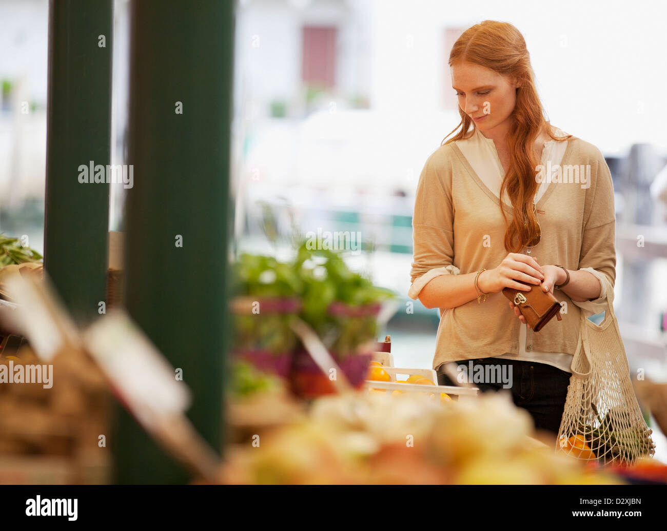 Woman shopping in outdoor market - Stock Image