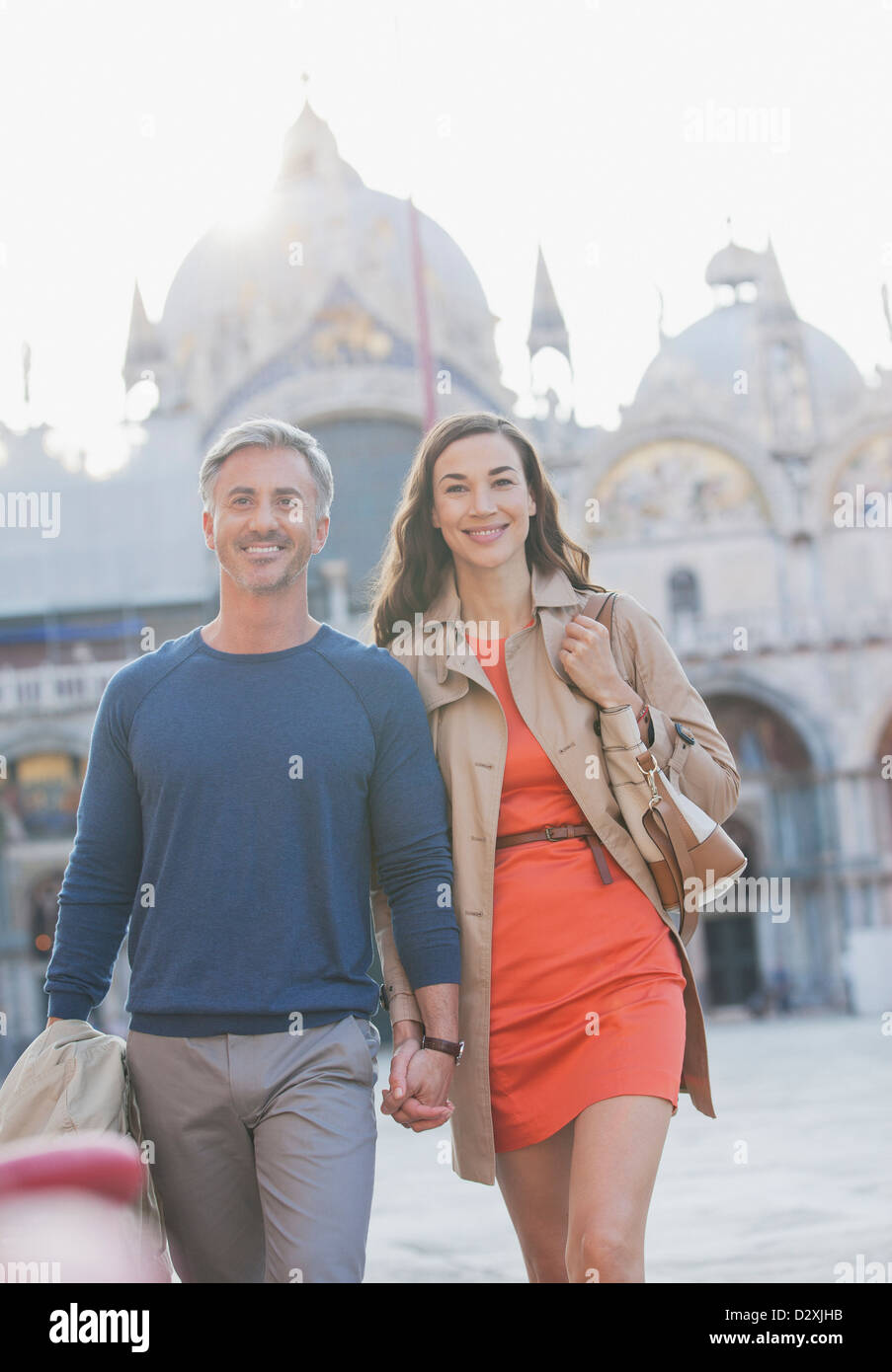 Portrait of smiling couple in St. Mark's Square in Venice - Stock Image