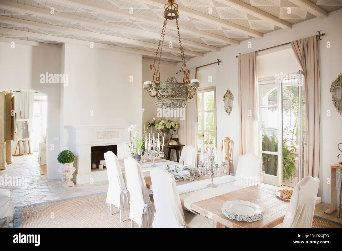 Chandelier over dining table in luxury dining room stock photo chandelier over dining table in luxury dining room aloadofball Images