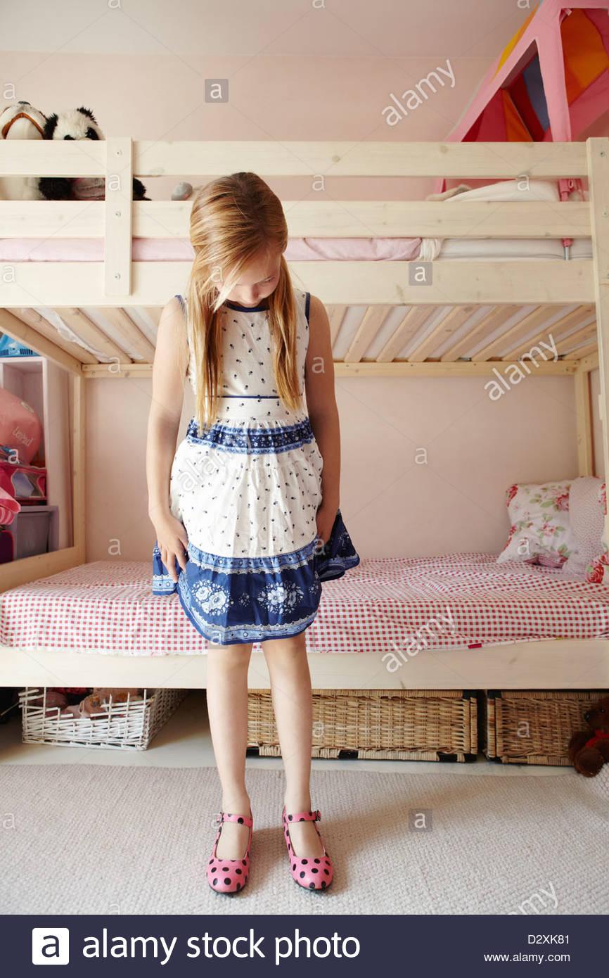 36ebb7120ece Girl wearing dress and looking down at polka-dot shoes Stock Photo ...