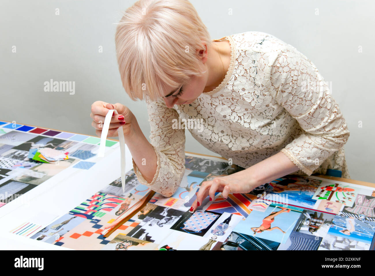 1be11213427 Young woman fashion designer working on mood boards for her portfolio -  Stock Image