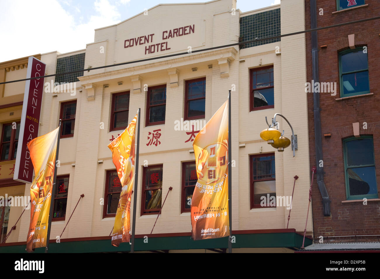 banners hanging in sydney's chinatown promote forthcoming chinese new year and year of the snake - Stock Image