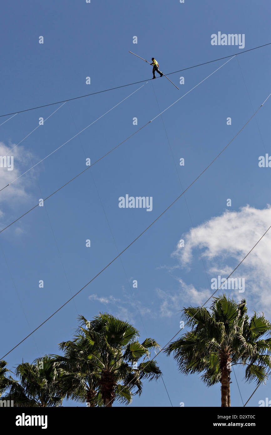 Famed daredevil Nik Wallenda walks a tightrope 200-feet over the waterfront January 29, 2013 in Sarasota, FL. Wallenda - Stock Image