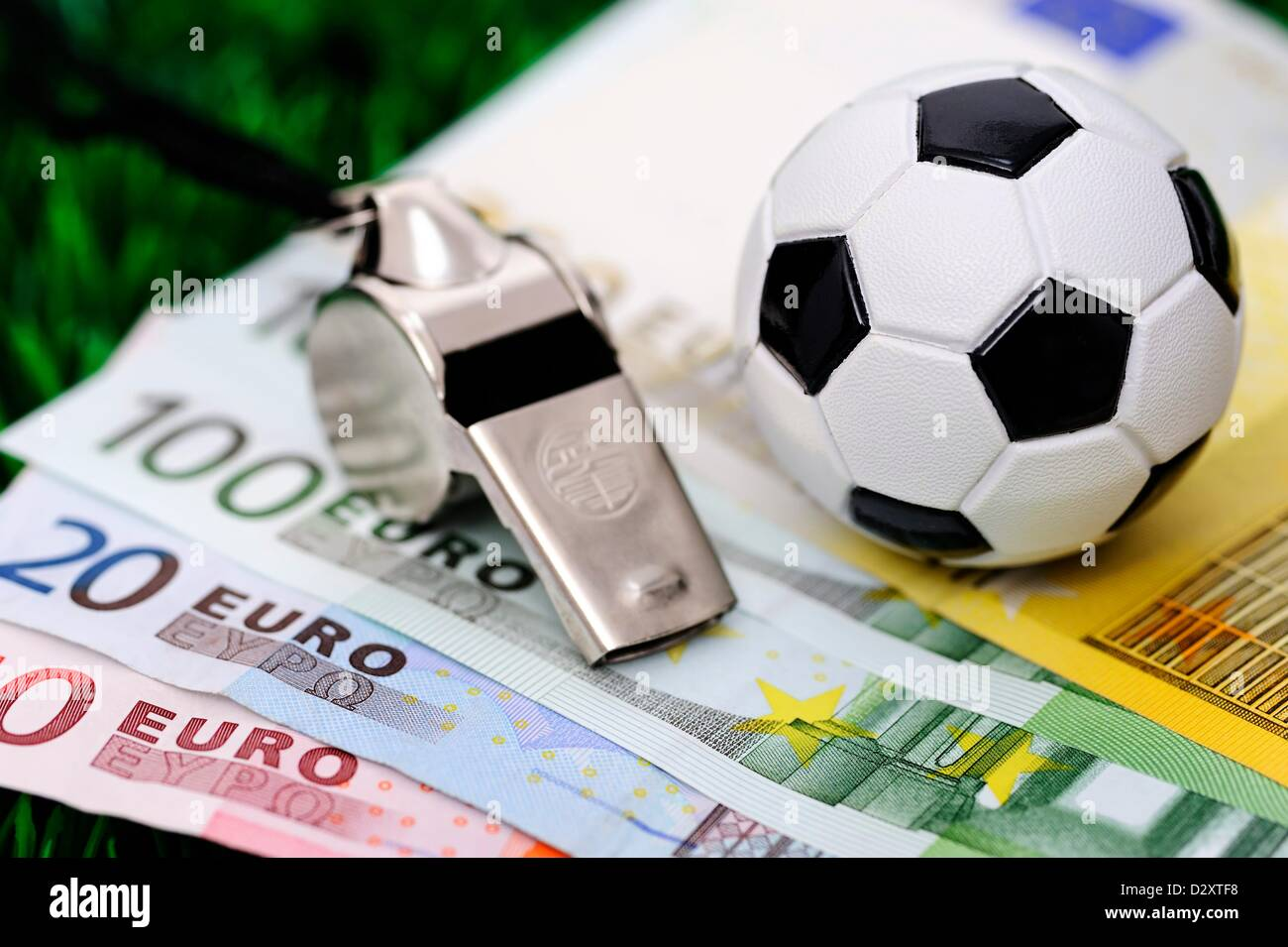 Soccer ball on euro banknotes - Stock Image
