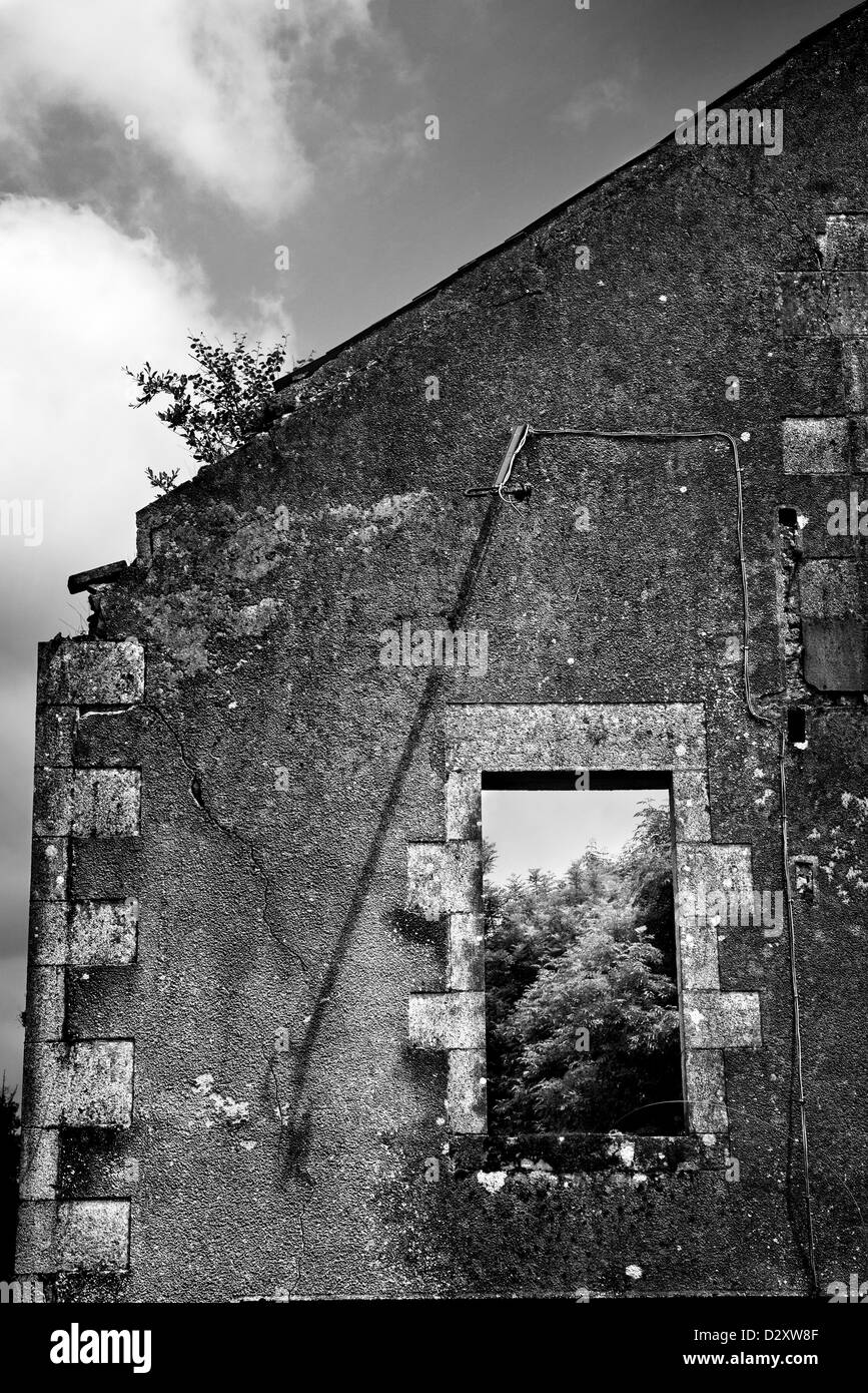 A destroyed houses remaining wall and window in the village Oradour sur Glane. - Stock Image