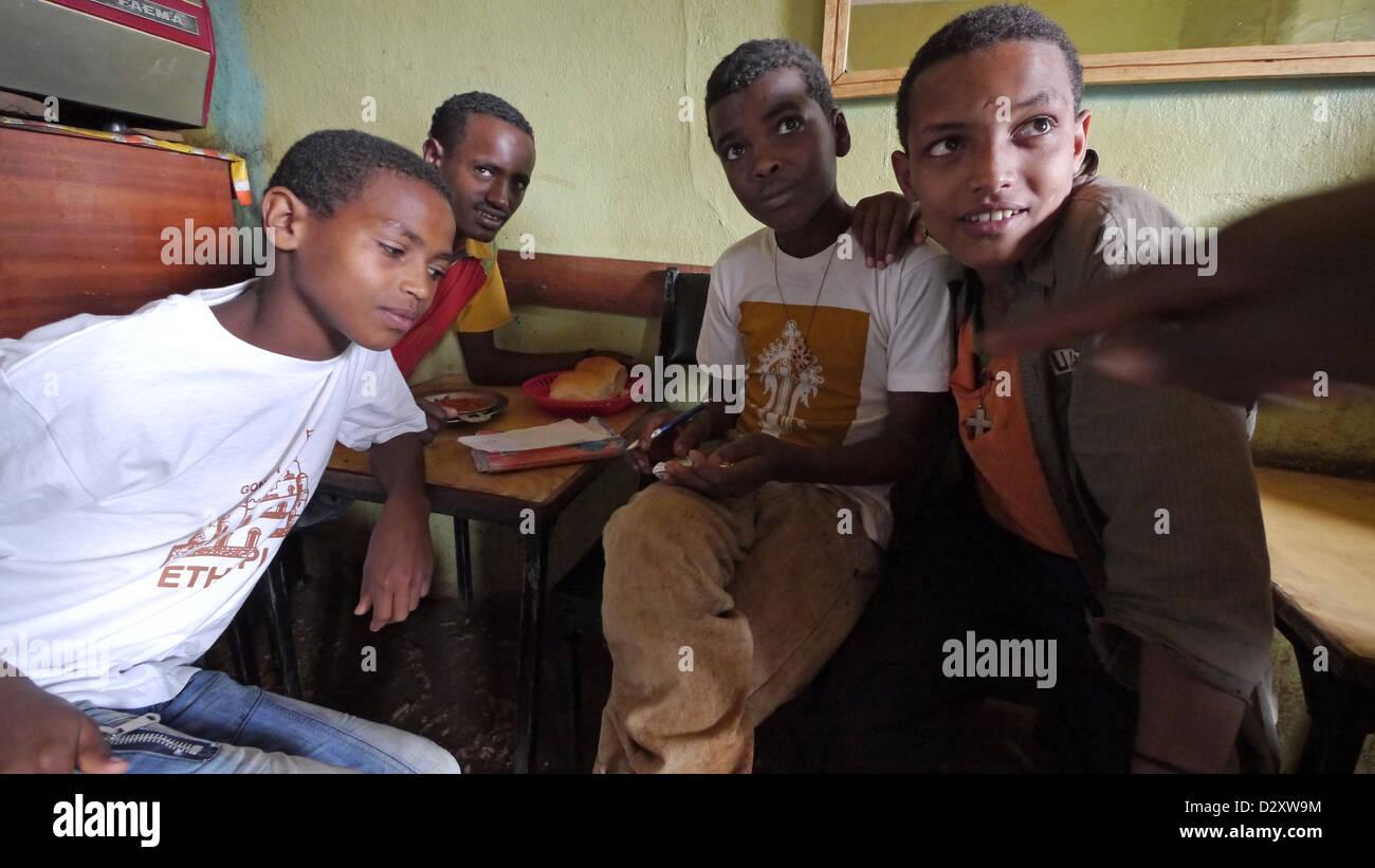 ethiopia salam cafe chagni beni shangul gumuz region boys having breakfast beans coffee children kids child Stock Photo