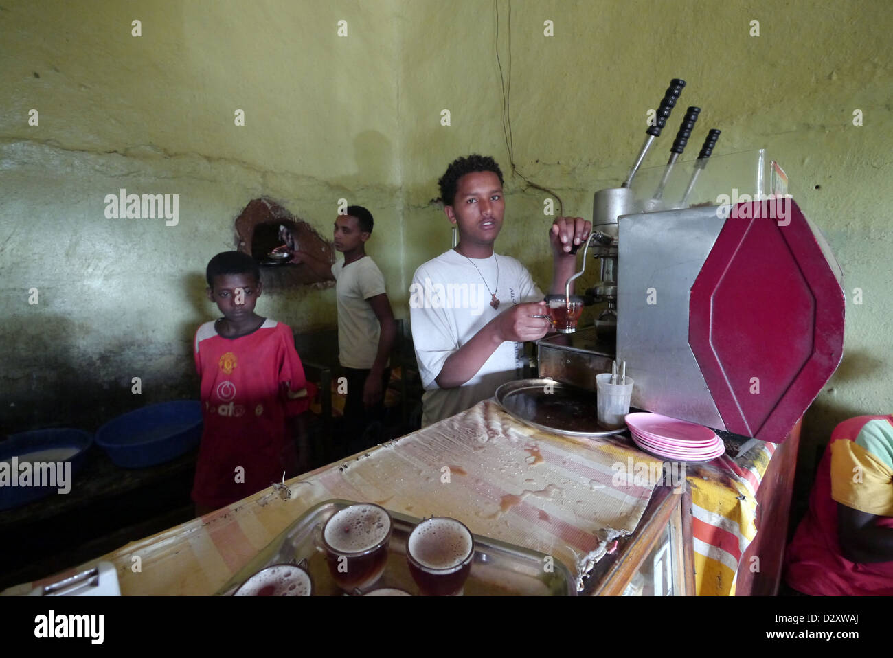 ethiopia salam cafe chagni beni shangul gumuz region employees espresso machine coffee labor food economy 2012 Stock Photo