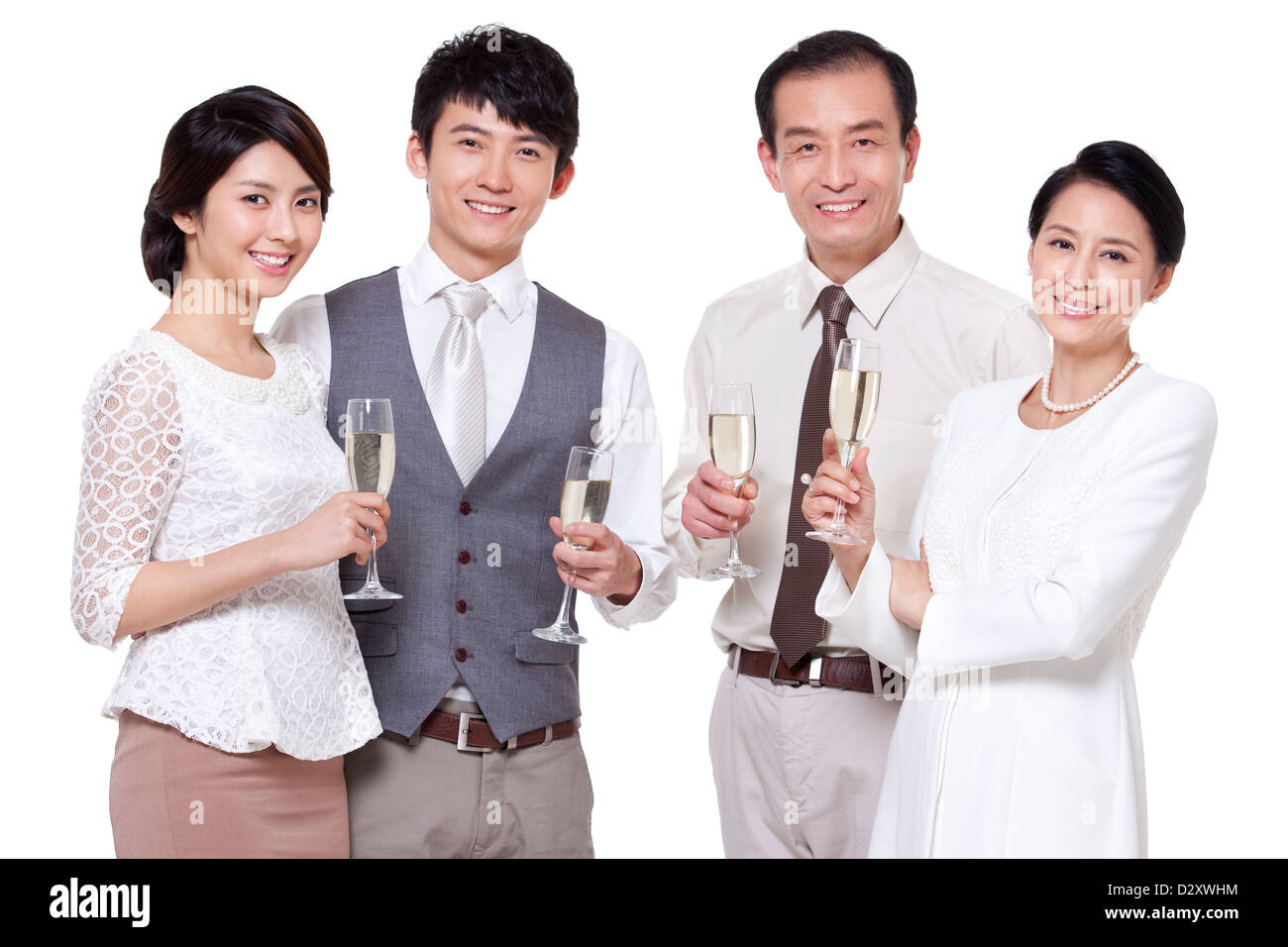 Wealthy family having champagne - Stock Image