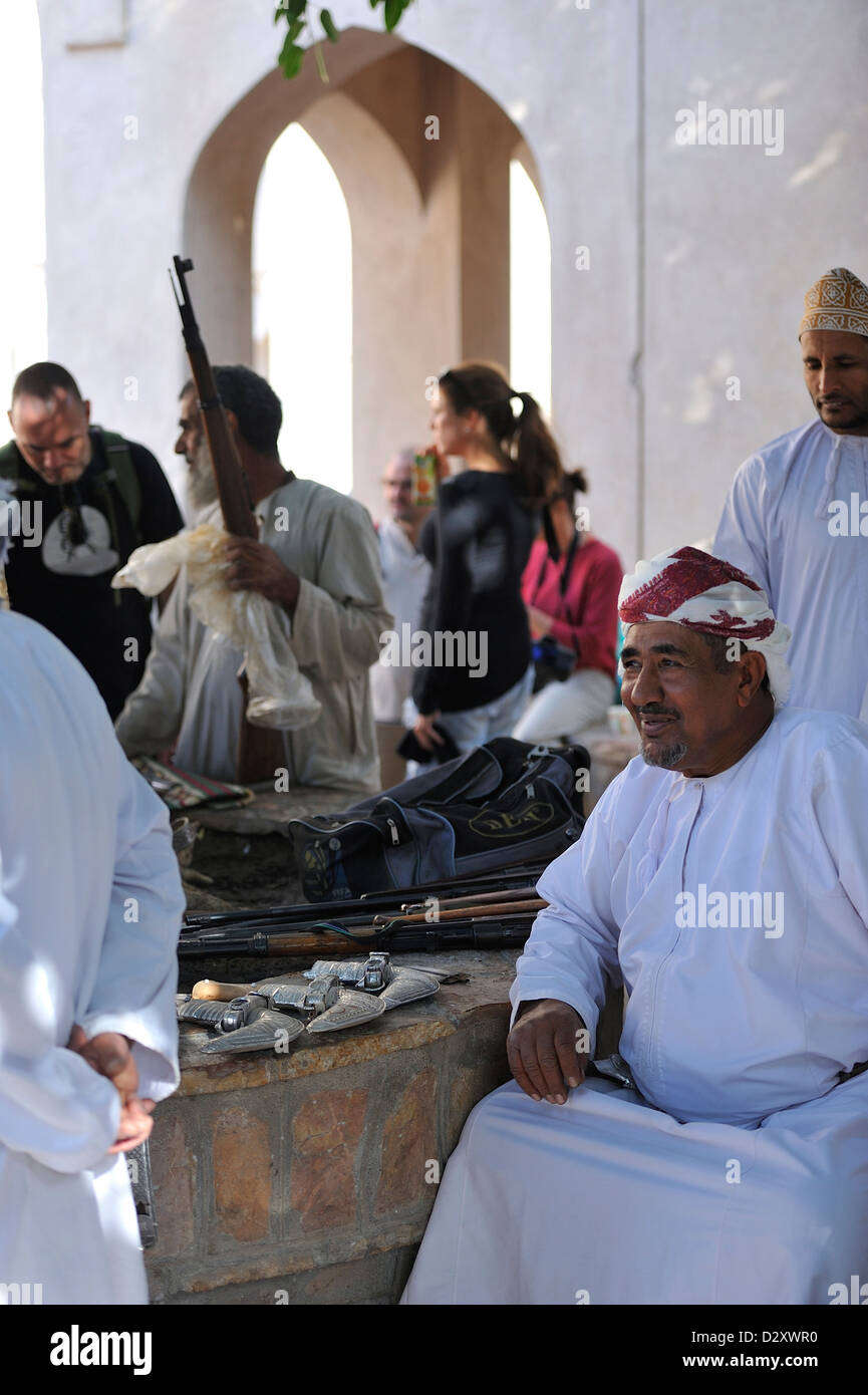 Trading rifles and khanjars (traditional omani dagger) in the East souk of Nizwa; Al Dakhiliyah, Oman. - Stock Image