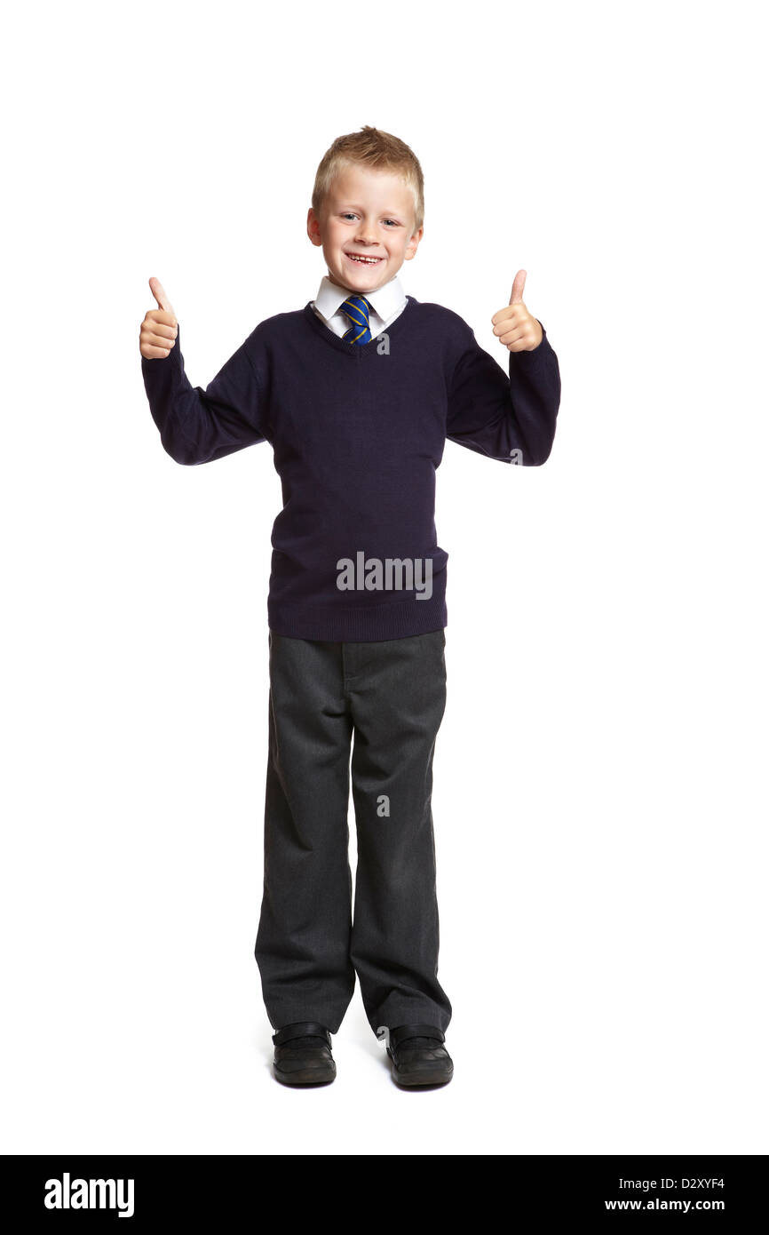 45f7dd84b2 8 year old school boy with thumbs up on white background - Stock Image