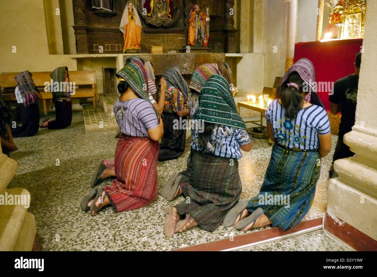 catholic church mayan women females praying santiago atitlan latin america central tribal indigenous 20121106 - Stock Image