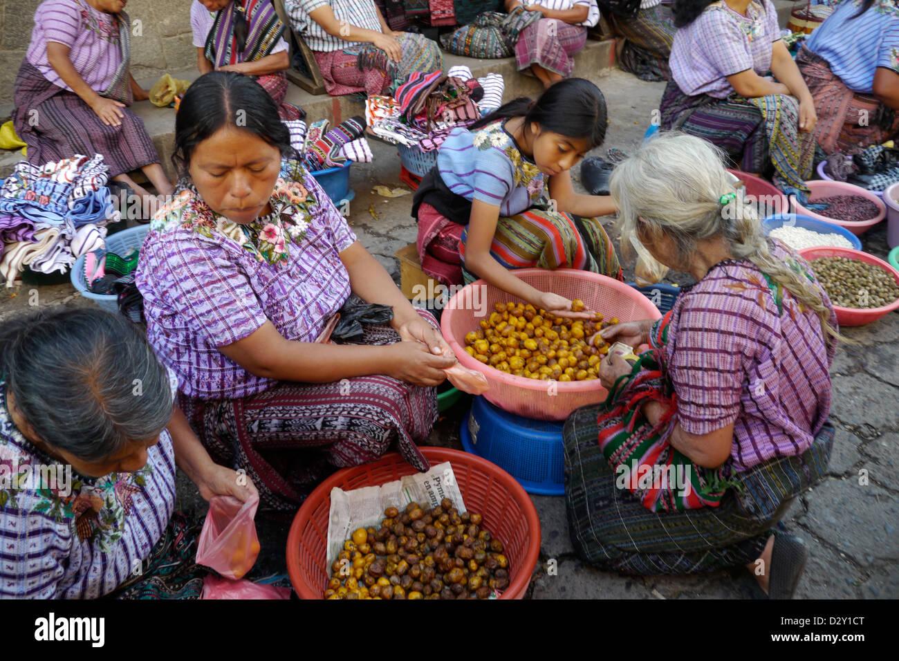 mayan market scenes santiago atitlan latin america central economy trade food tribal indigenous woman female - Stock Image