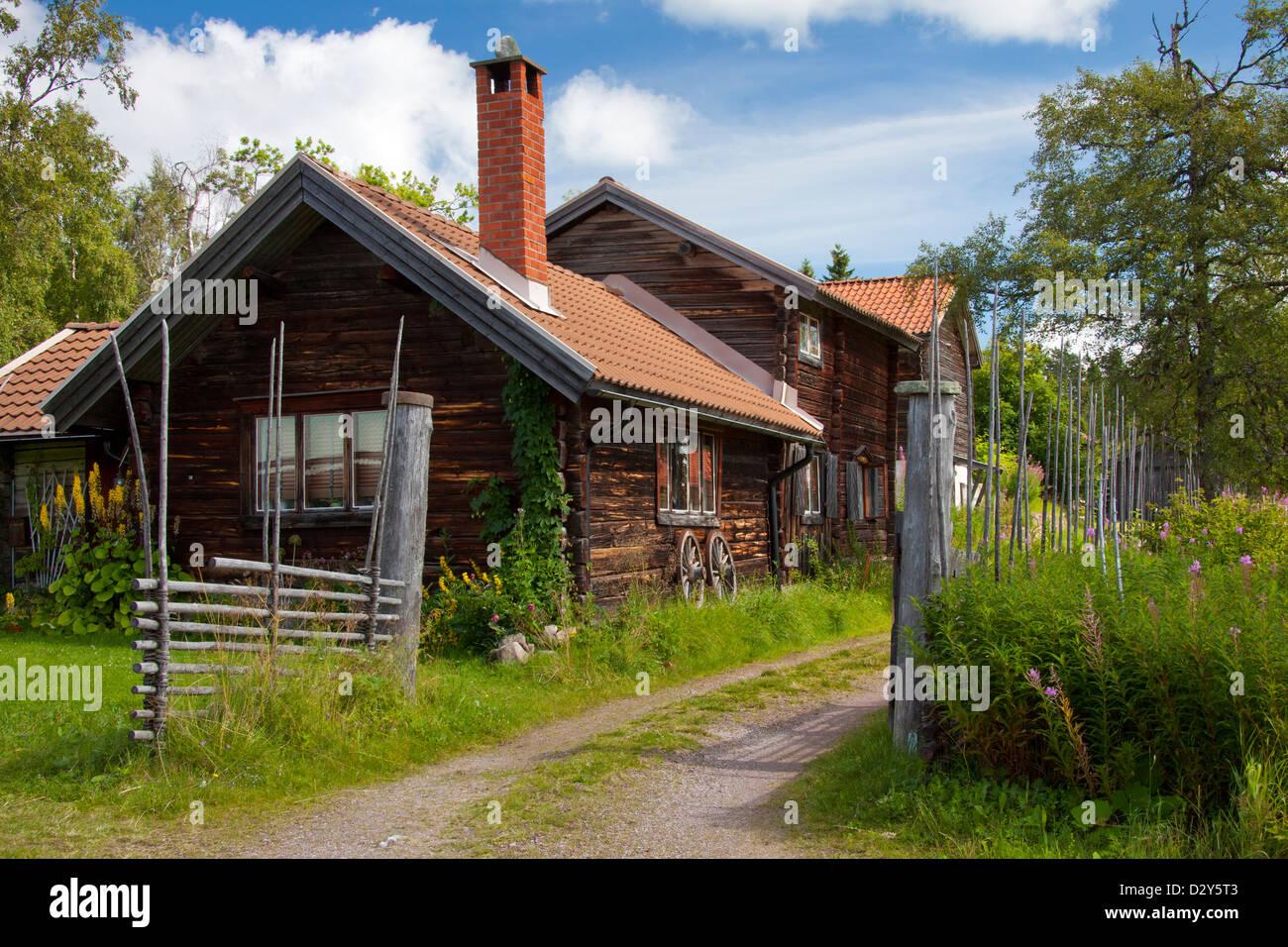 Traditional old wooden cottages / log cabins at the village Fryksås, Dalarna, Sweden, Scandinavia - Stock Image