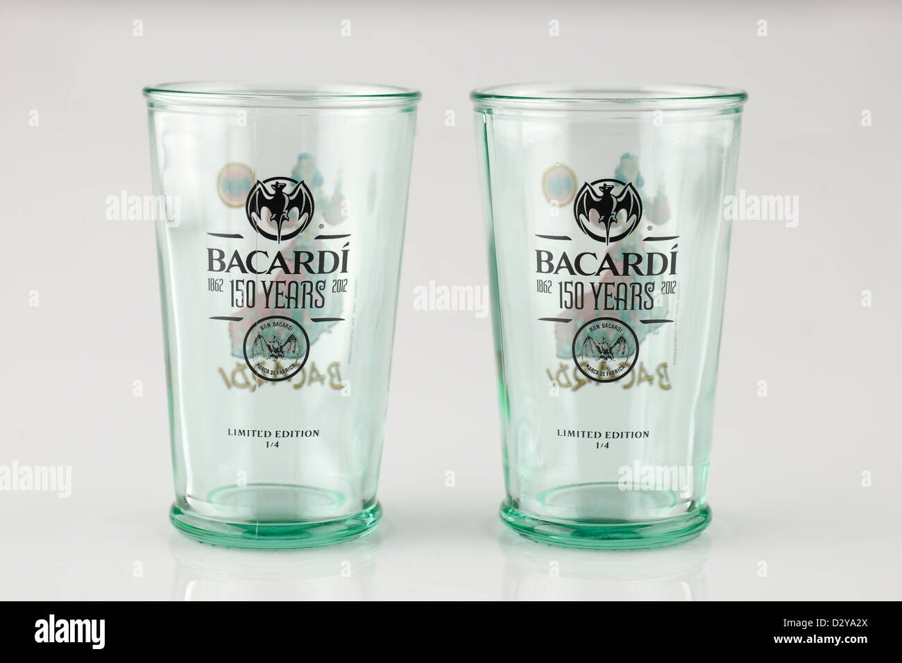 Two limited edition thick glass Bacard glass tumblers celebrating 150 years of production 1862 to 2012 - Stock Image