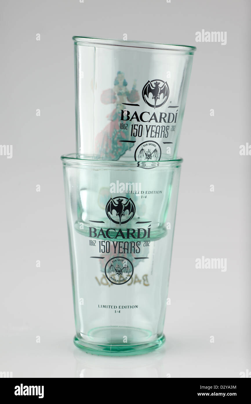 Two limited edition thick glass Bacardi glass tumblers celebrating 150 years of production 1862 to 2012 - Stock Image