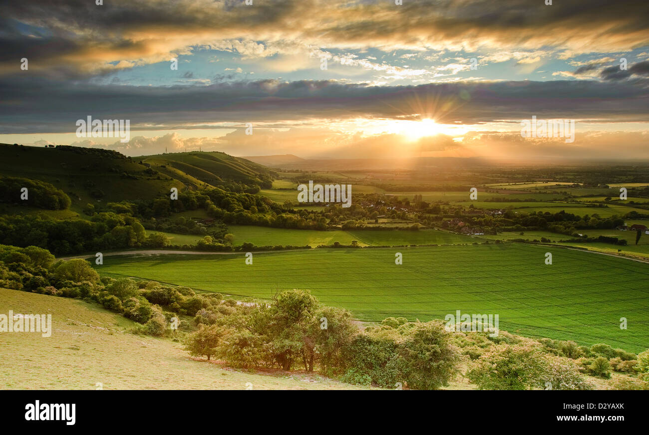 Landscape over English countryside landscape in Summer sunset - Stock Image