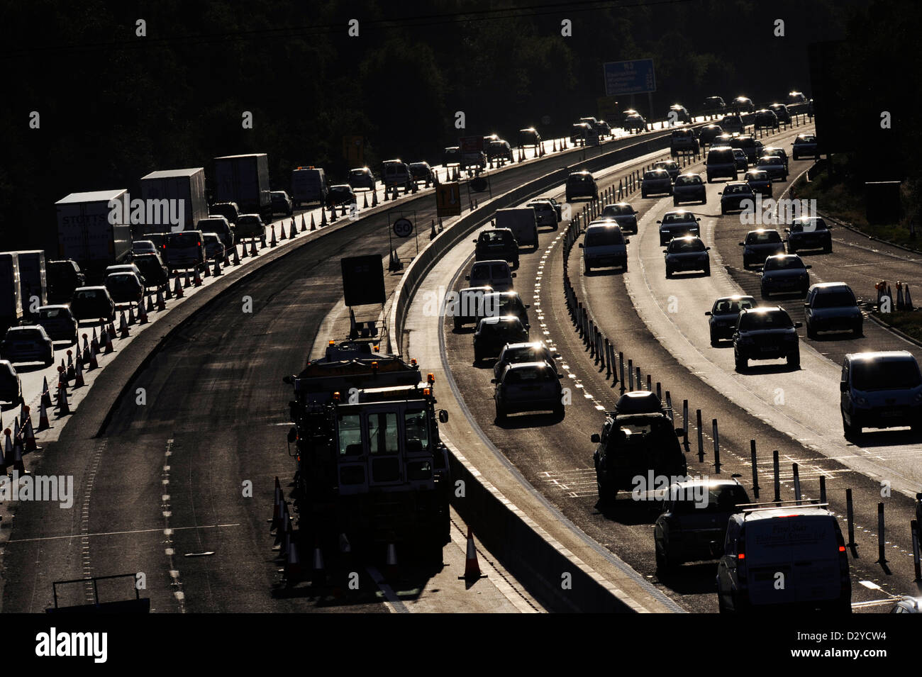Cars queue and are delayed as traffic builds during maintenance on the M3, a UK motorway Stock Photo
