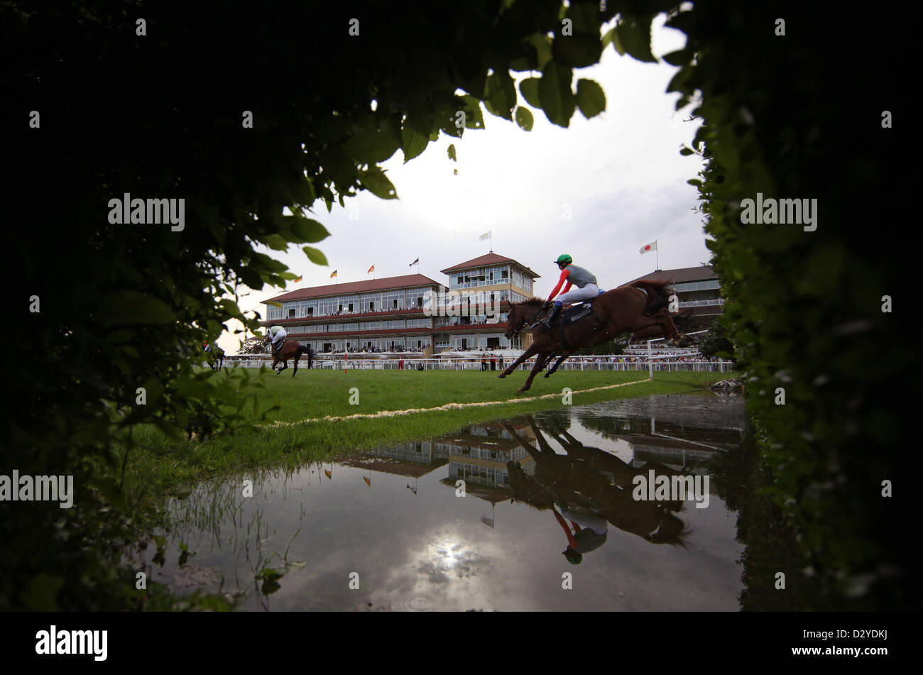 Iffezheim, Germany, horses and jockeys jump over the ditch Stock Photo