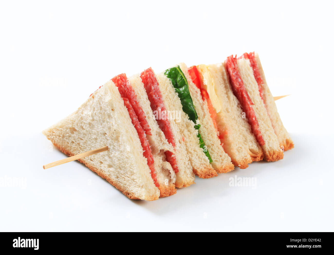 Multi-layered sandwich with thin sliced salami - Stock Image