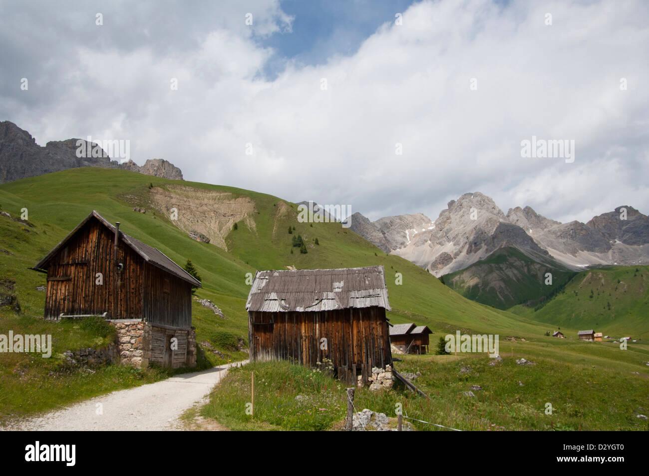Typical mountain hut, typical historical mountain house, Marmolada on the background, Località Fuchiade, Soraga, Stock Photo