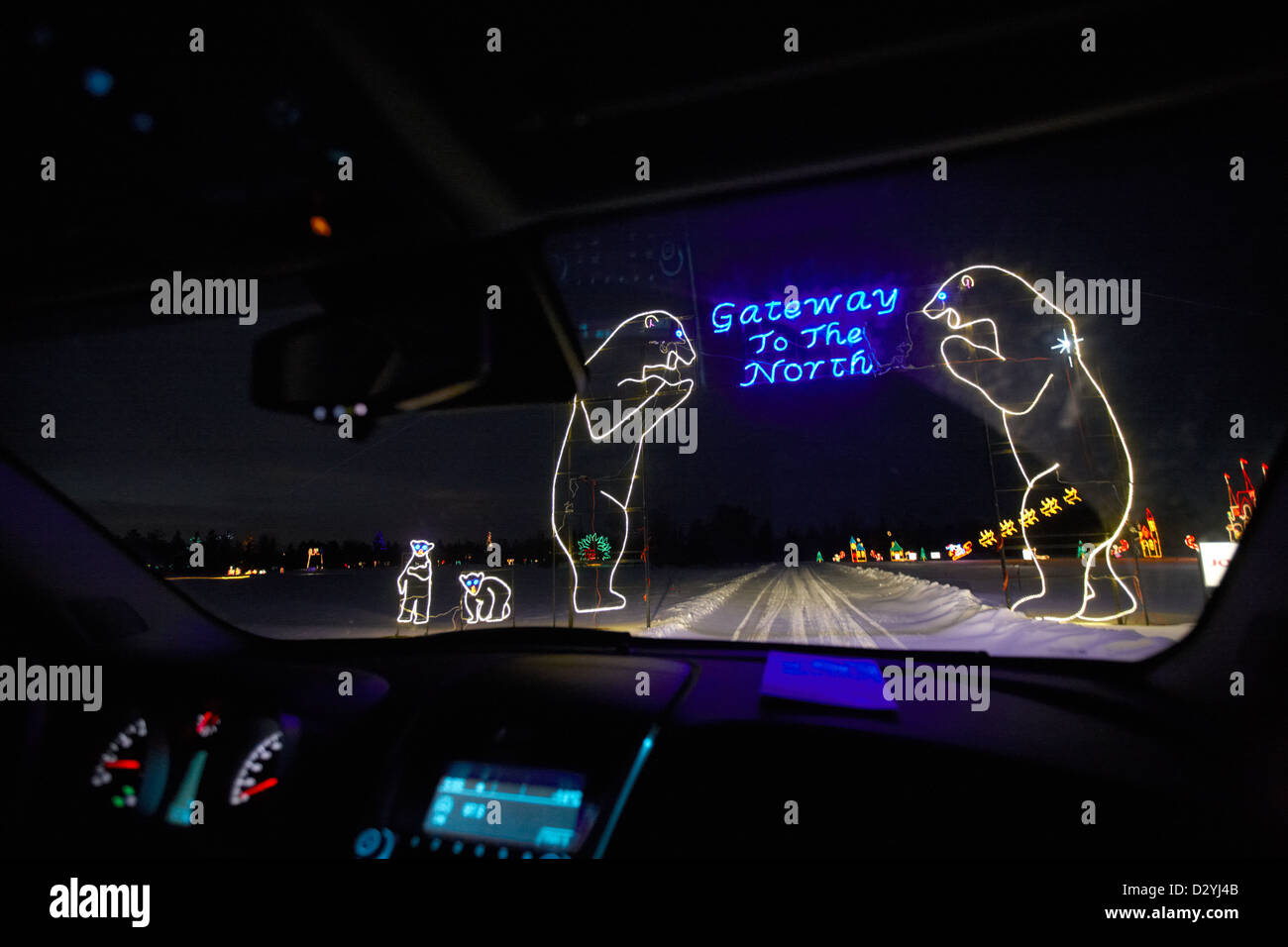 driving through illuminated enchanted forest attraction at night Saskatoon Saskatchewan Canada - Stock Image