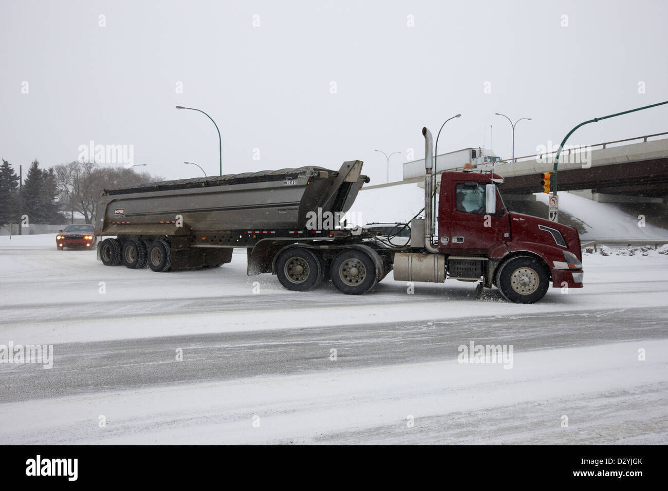 Tow Truck Saskatoon >> Large Freight Truck Towing Load On Frozen Road In Falling