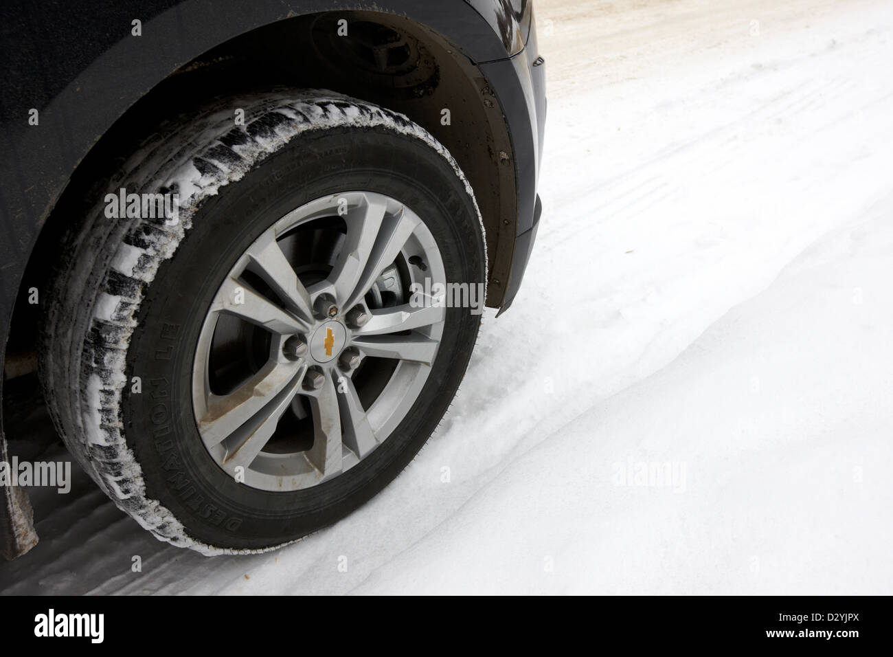 suv all weather car tire in the snow Saskatoon Saskatchewan Canada - Stock Image