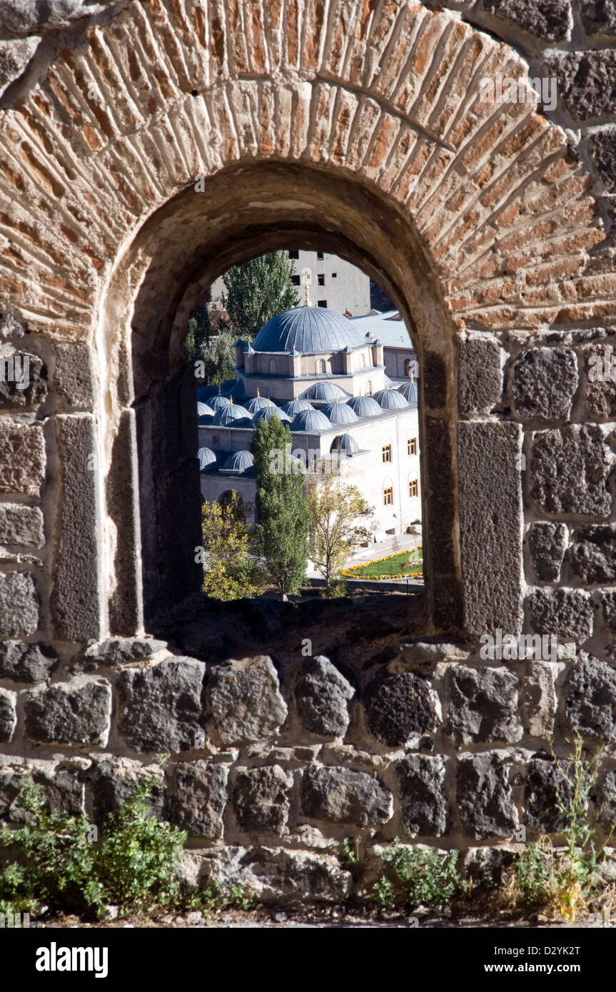 A Turkish mosque seen through a window from the citadel of Kars, in eastern Turkey. - Stock Image