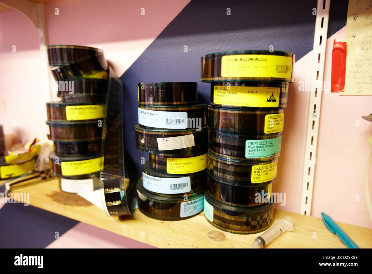 35mm cinema films on shelf in old cinema projection room Biggar Saskatchewan Canada - Stock Image
