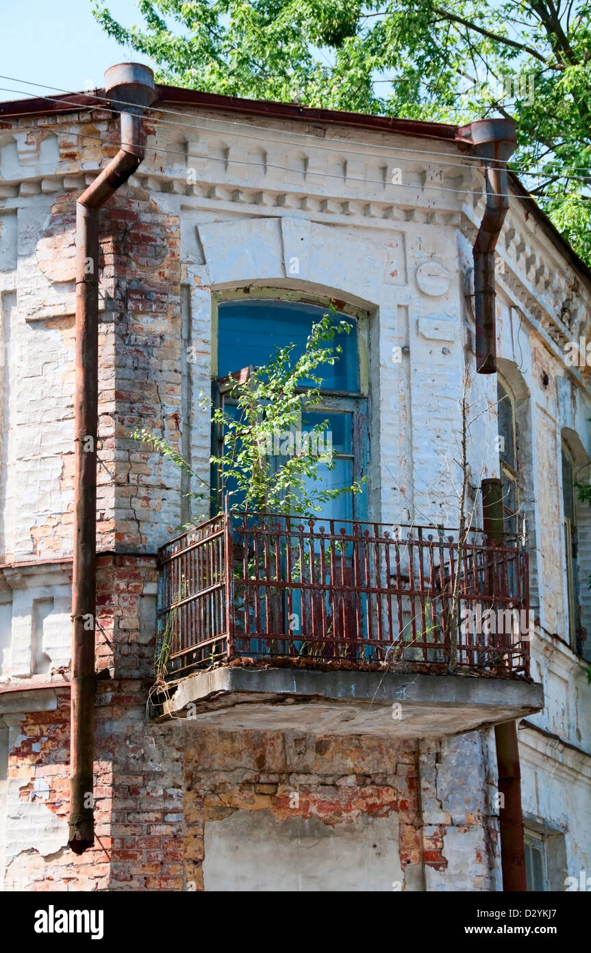 Chernobyl disaster results. This is an abandoned house in Chernobyl city - Stock Image
