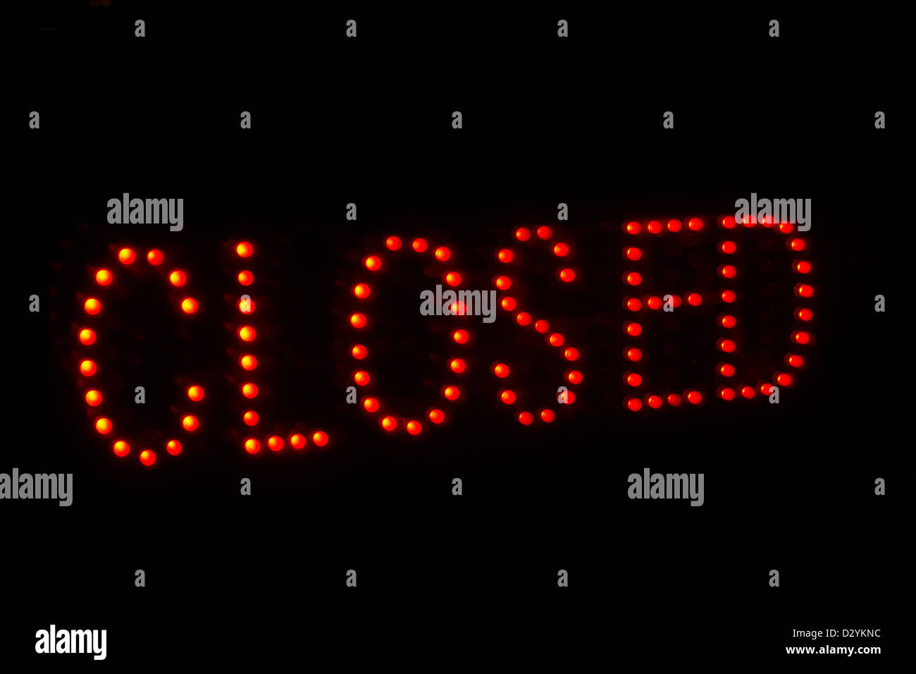 led closed sign at night in a shop window - Stock Image