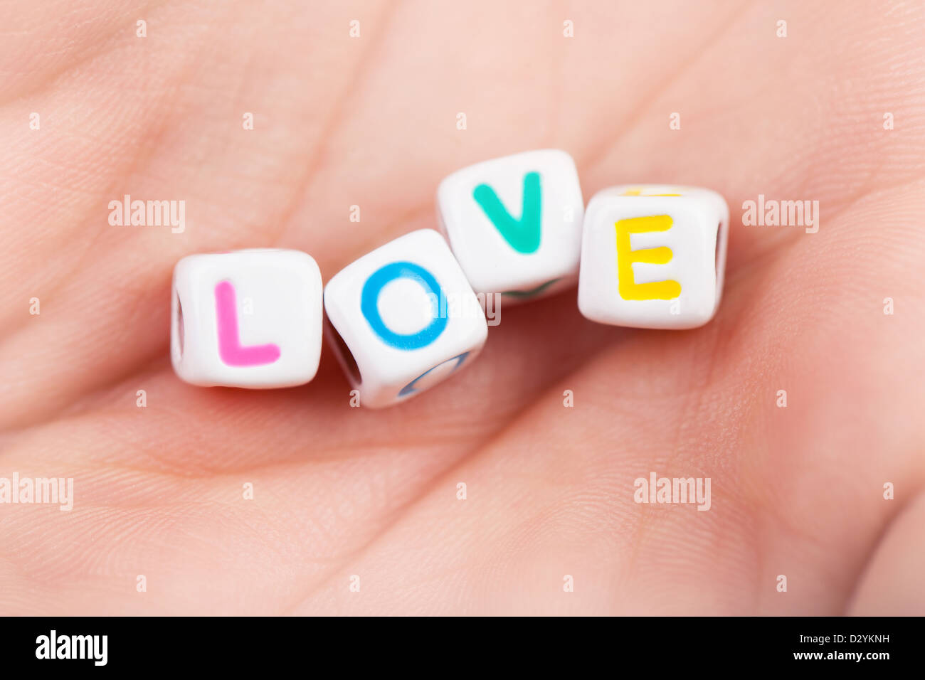 Photo of game cubes with love word on woman\'s palm, romantic holiday ...