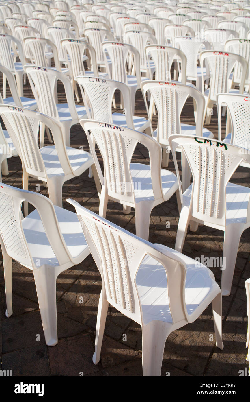 White plastic chairs lined up for a political rally in the town square in Granada Nicaragua. - Stock Image