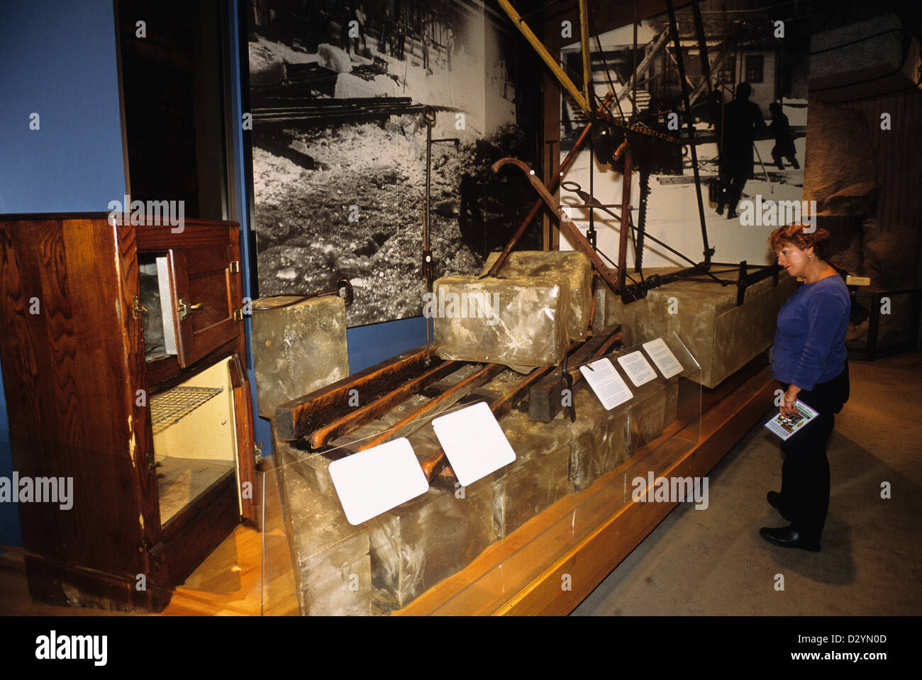 Elk282-1027 Maine, Augusta, Maine State Museum, woman viewing ice cutting exhibit - Stock Image