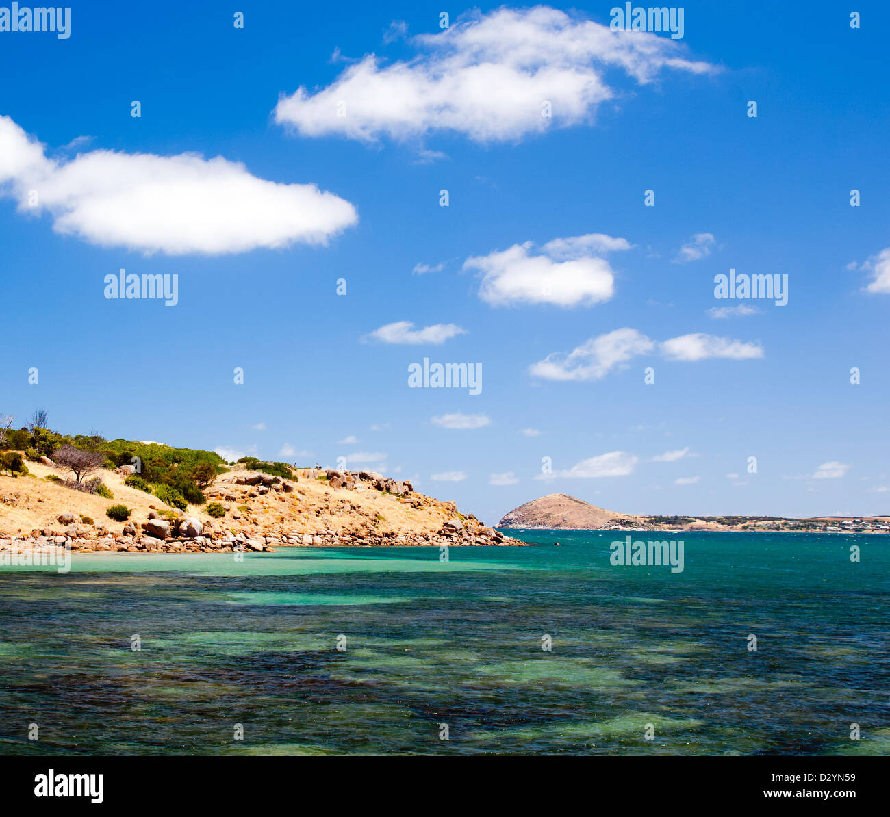 View across clear water to Granite Island, South Australia Stock Photo